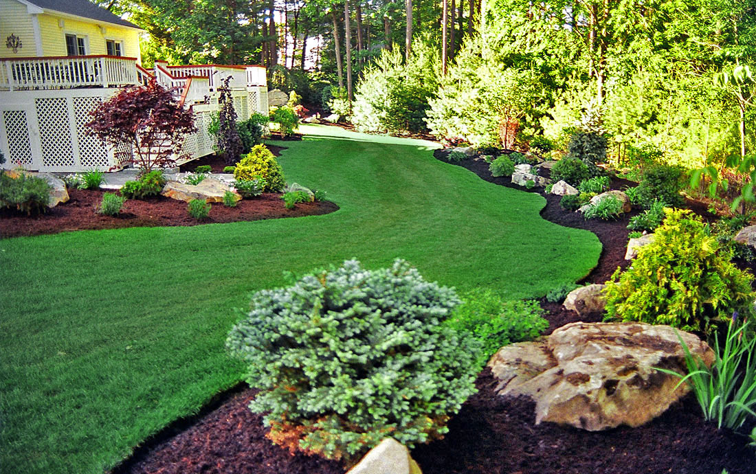 Norton landscaping backyard transformation for Landscaping ideas for backyard
